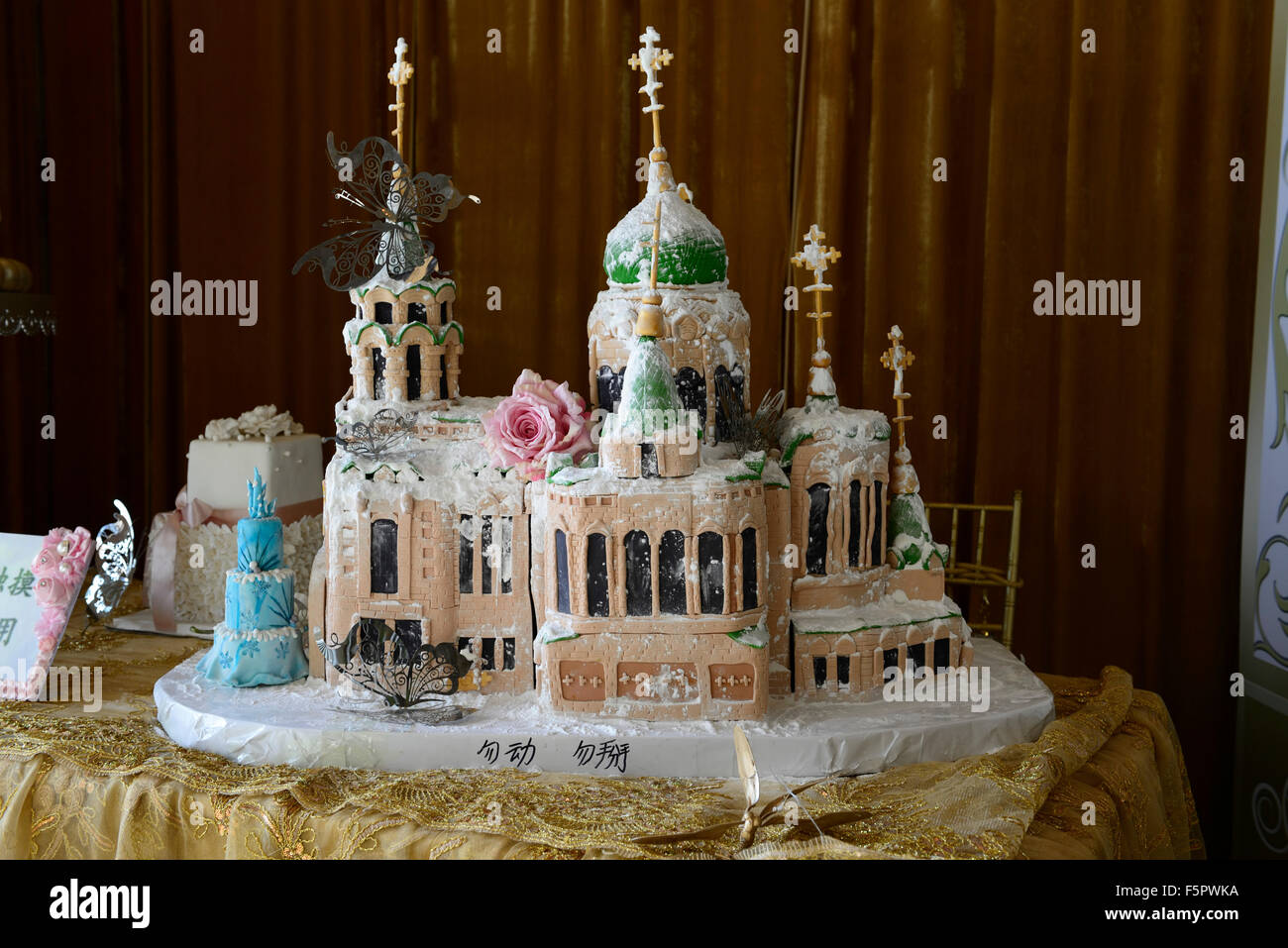 Elaborate wedding cake orthodox religious building church cathedral edible food celebration celebrate Harbin China - Stock Image