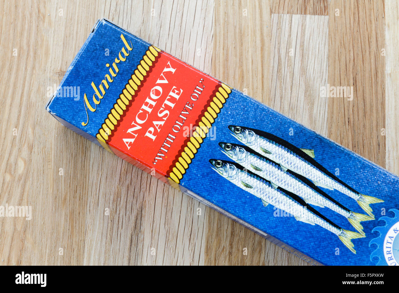 Box containing tube of anchovy paste - Stock Image