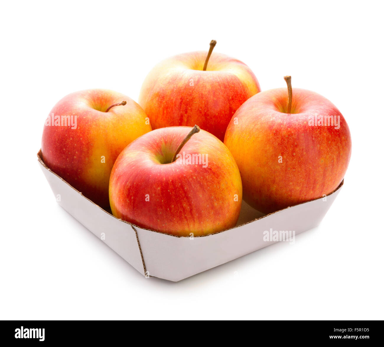 four apples in box isolated over white background fresh fruit