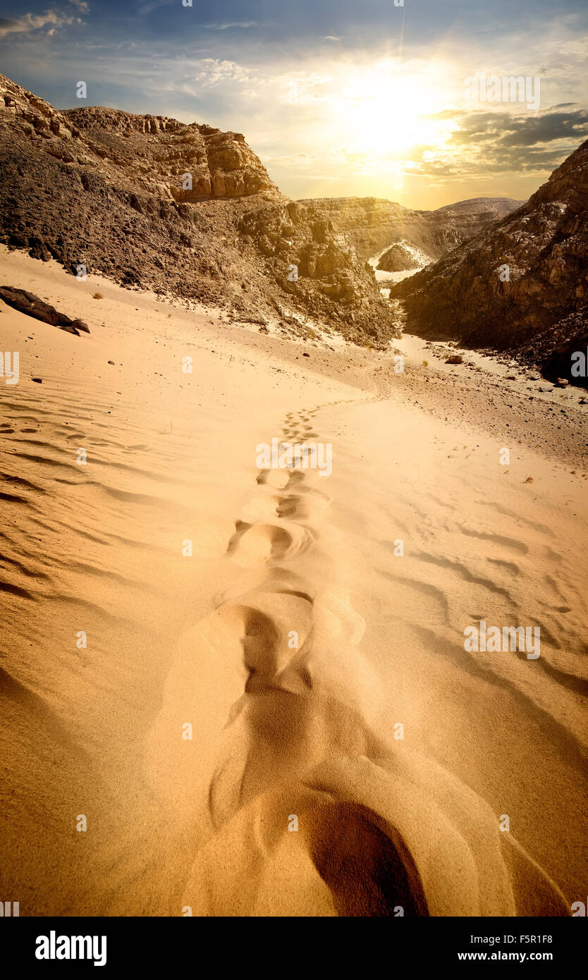 Mountains and sand dunes at the sunset - Stock Image