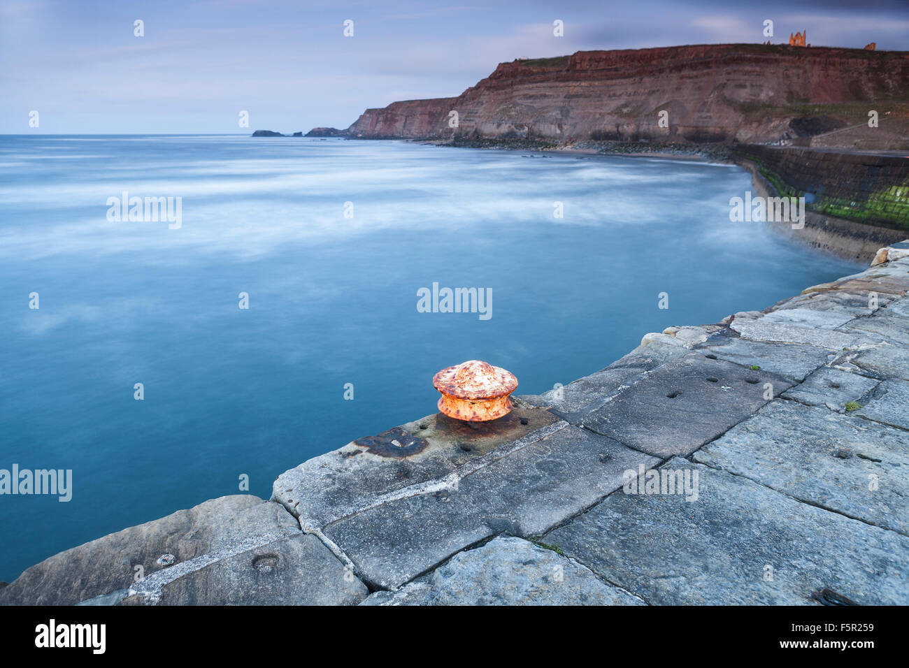 A rusting bollard on the pier at Whitby, North Yorkshire. Stock Photo