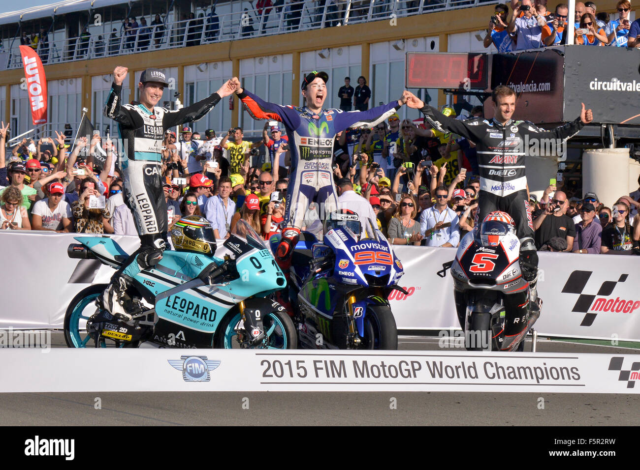 The three world champions motorcycling, Jorge Lorenzo,  Danny Kent and Johann Zarco, celebrating the MotoGP World - Stock Image