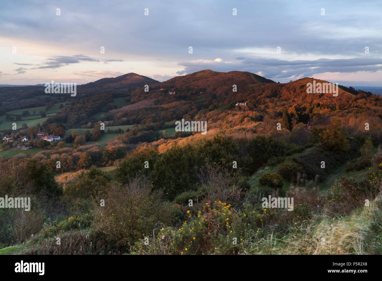 A small shaft of light shines on the Malvern Hills in winter from British Camp, Herefordshire. Stock Photo