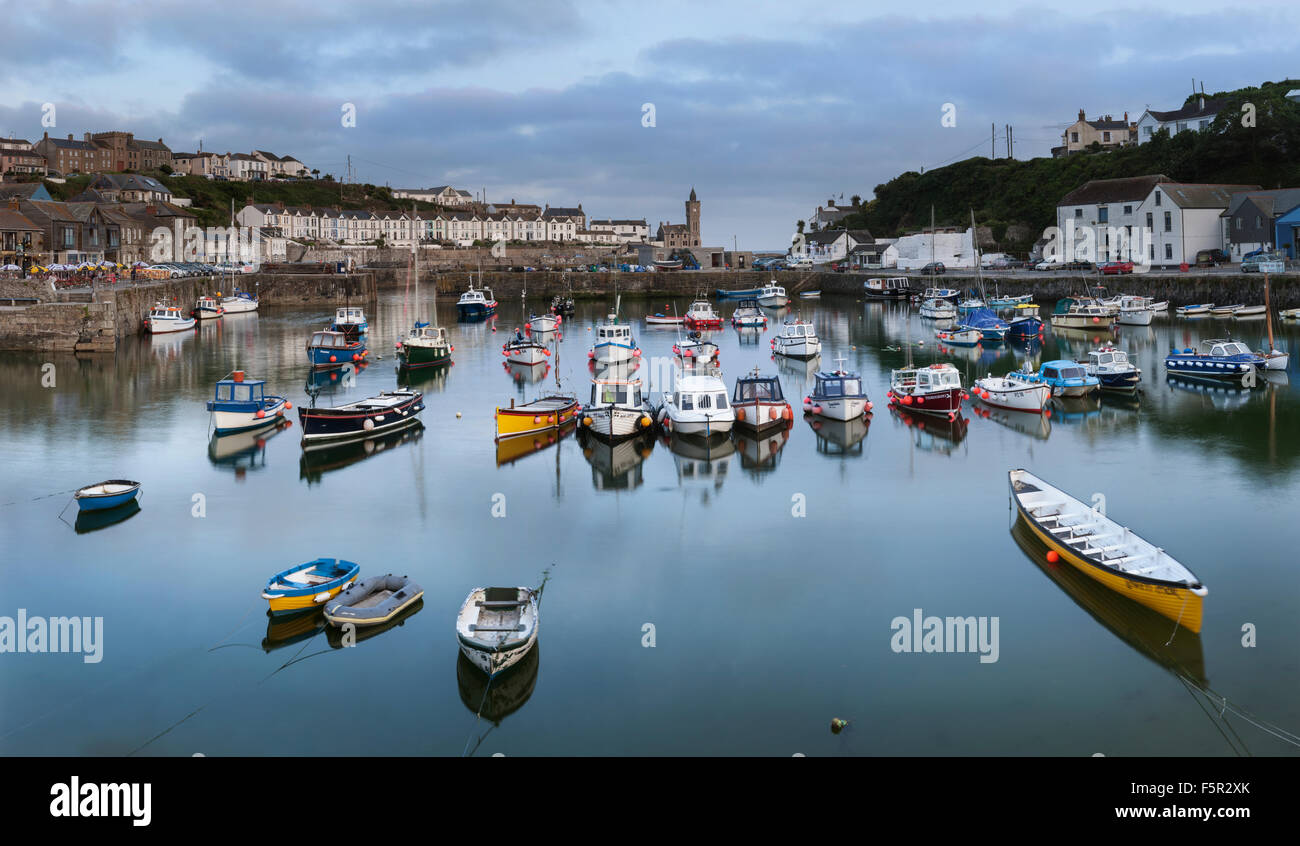 Fishing boats and rowing boats in the harbour at Porthleven, Cornwall Stock Photo