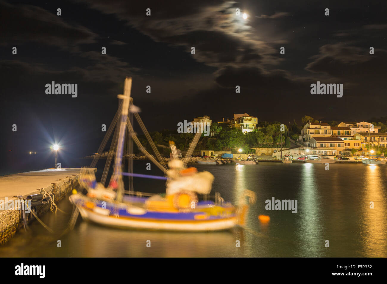 A Greek fishing boat is moored up overnight in the harbour at Kassiopi, Corfu, Greece. Stock Photo