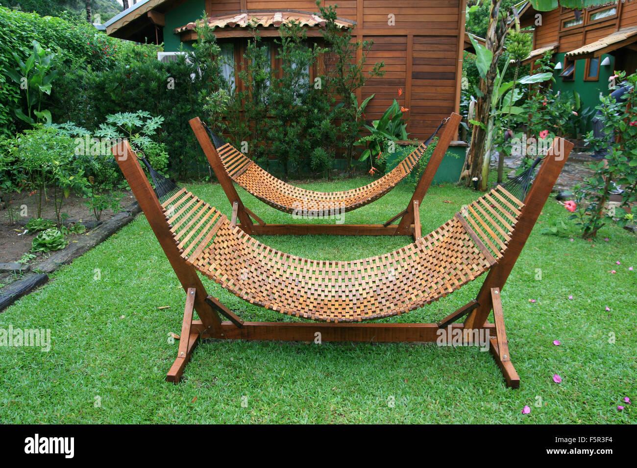 Two luxury hammocks in a green garden - Stock Image