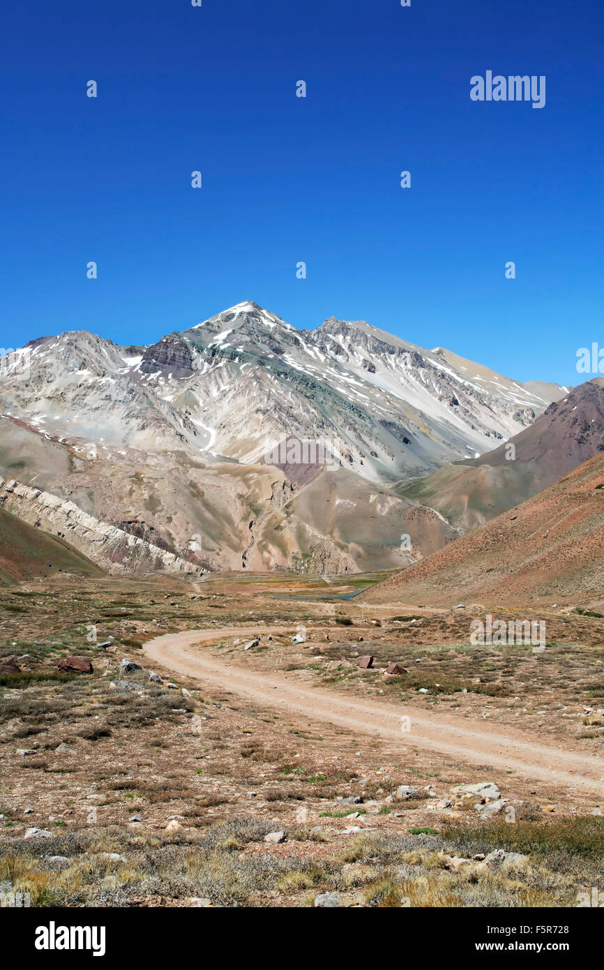Yesero Peak (11,847 ft.) and road, from Aconcagua Provincial Park, Mendoza Province, Argentina - Stock Image