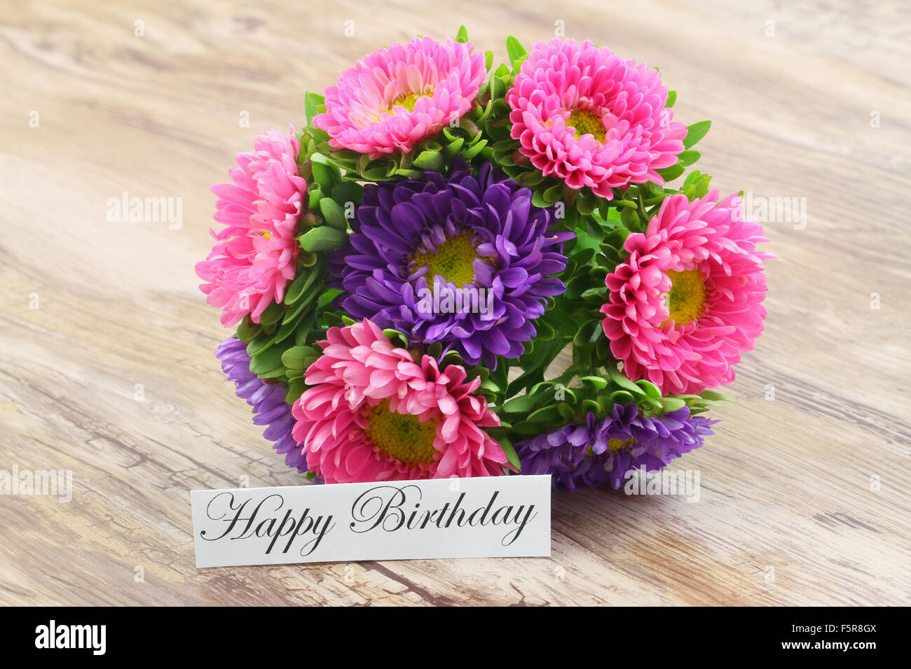 Happy birthday card with colorful aster flowers bouquet stock photo happy birthday card with colorful aster flowers bouquet izmirmasajfo