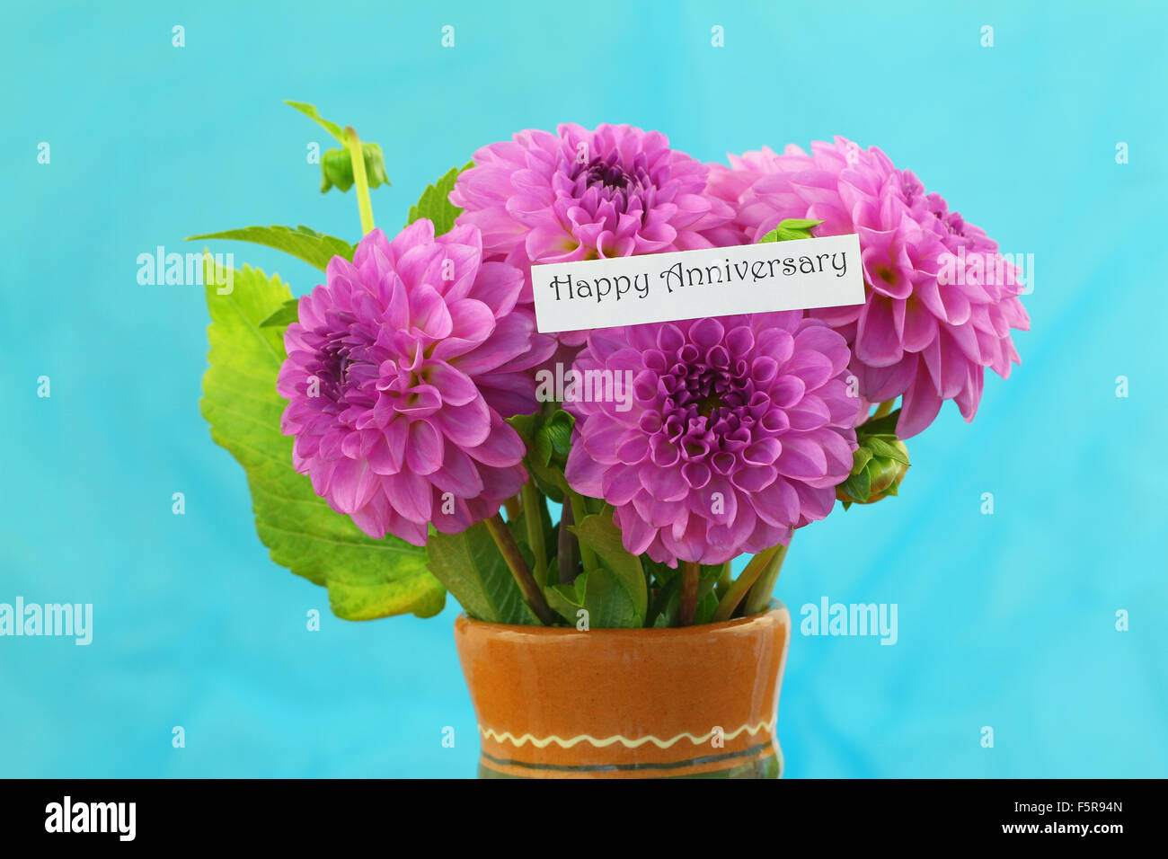 Happy Anniversary card with pink dahlia flowers bouquet on blue ...