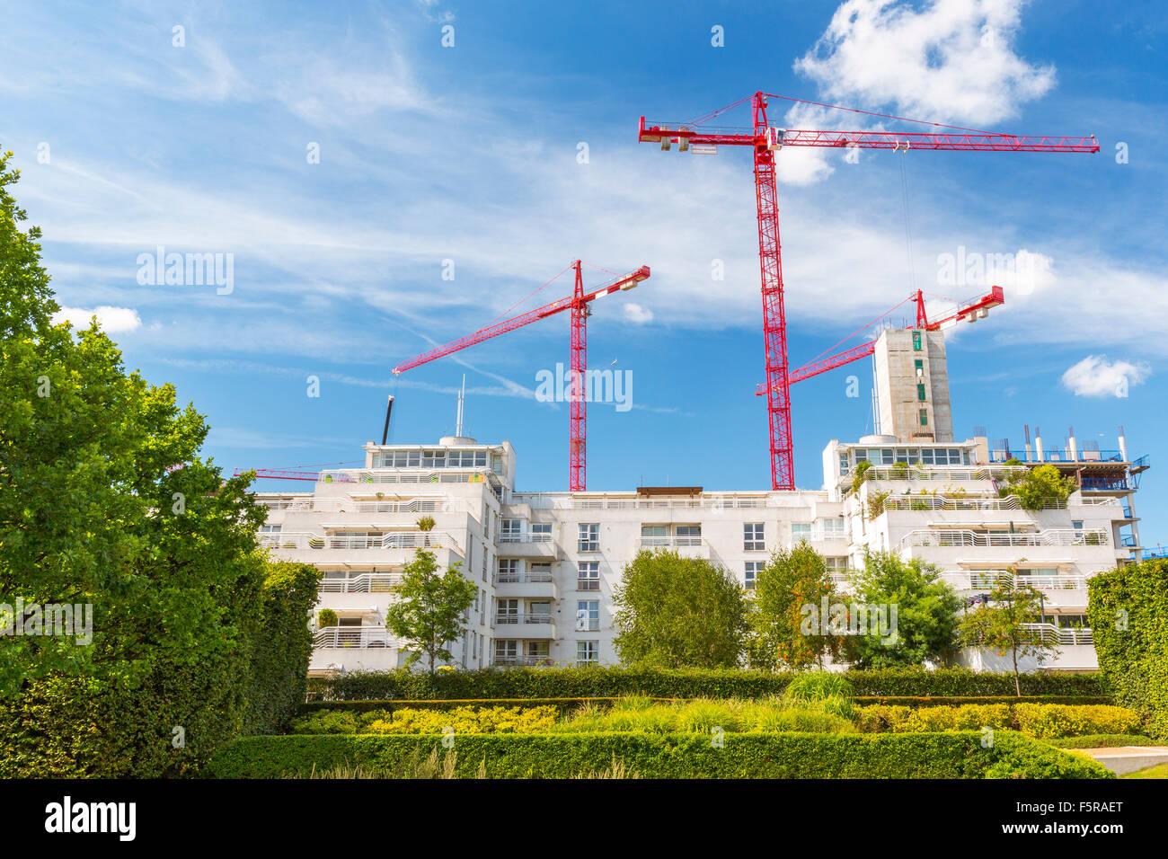 Construction Tower Cranes dominating a London Suburb skyline, England, UK - Stock Image