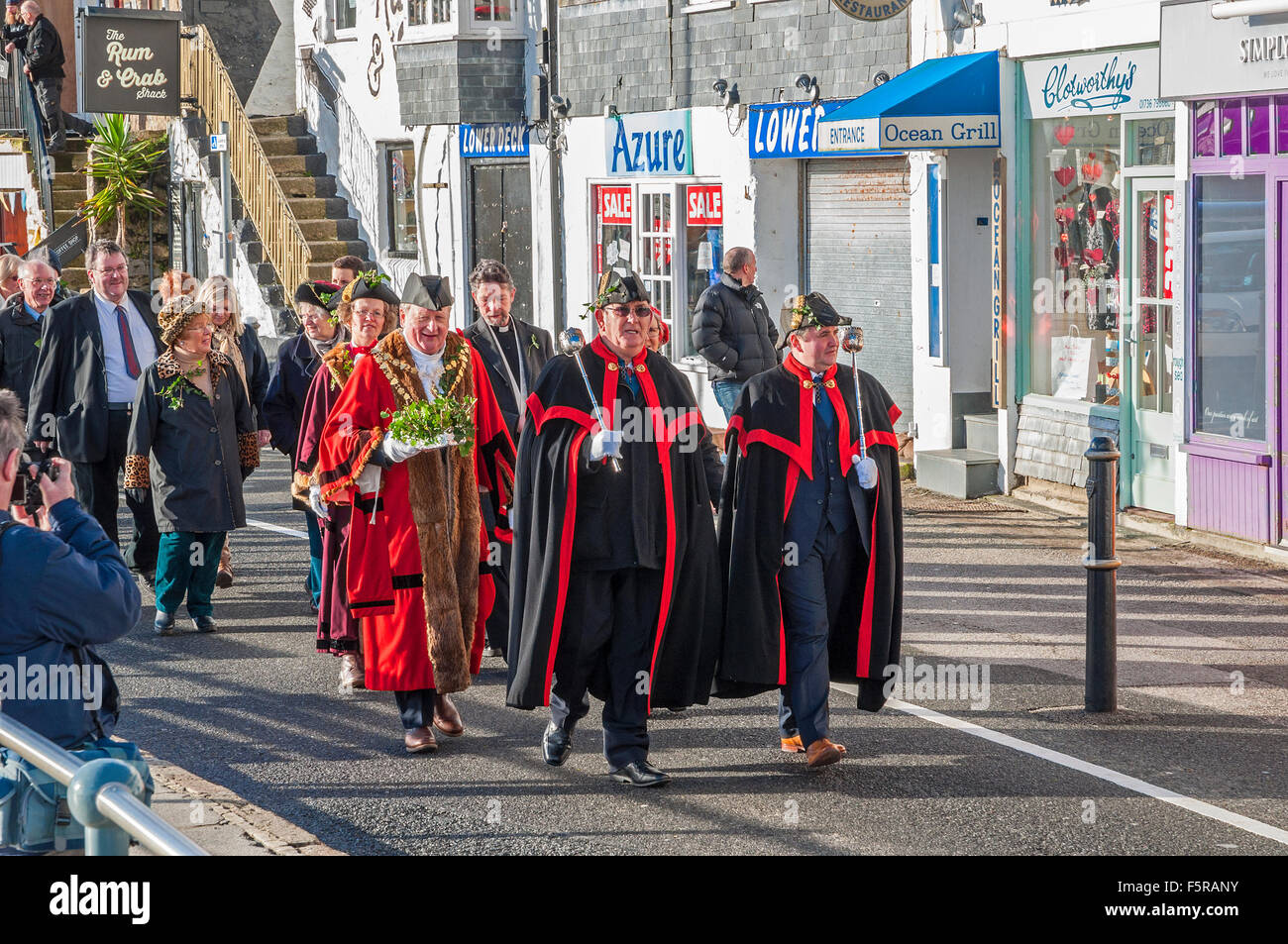 The Mayor and town council officials marching through the streets during the Annual Feast Day celebrations - Stock Image