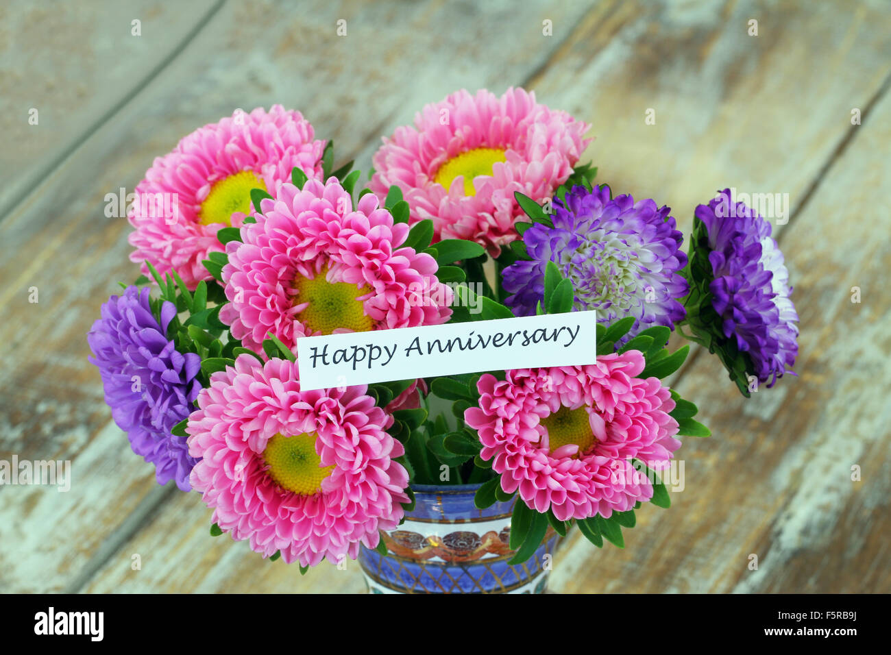 Happy Anniversary Card With Colorful Aster Flowers Bouquet On Rustic