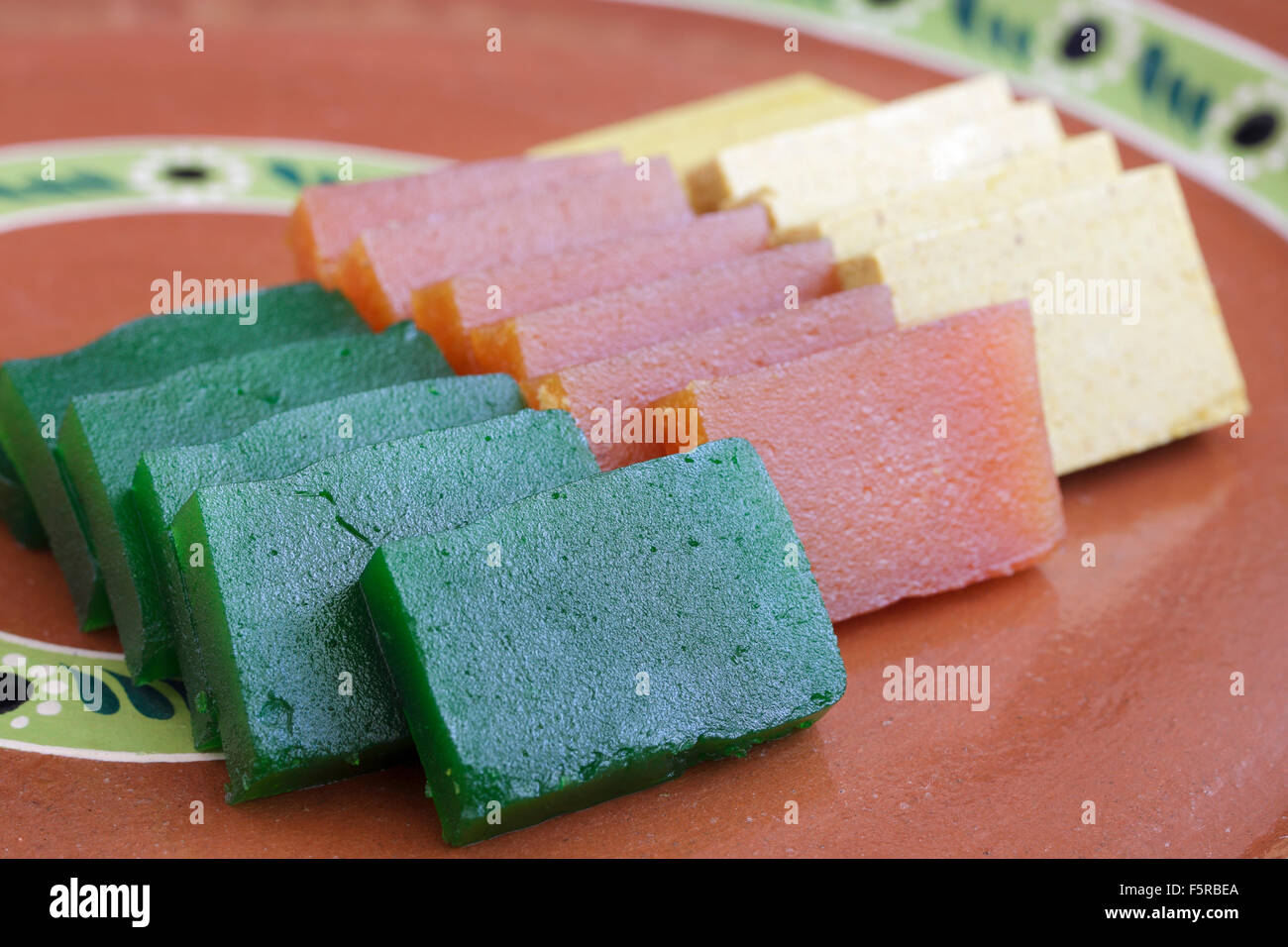 Slices of 'ate', a fruit paste candy traditional to Morelia, Michoacan, Mexico. - Stock Image