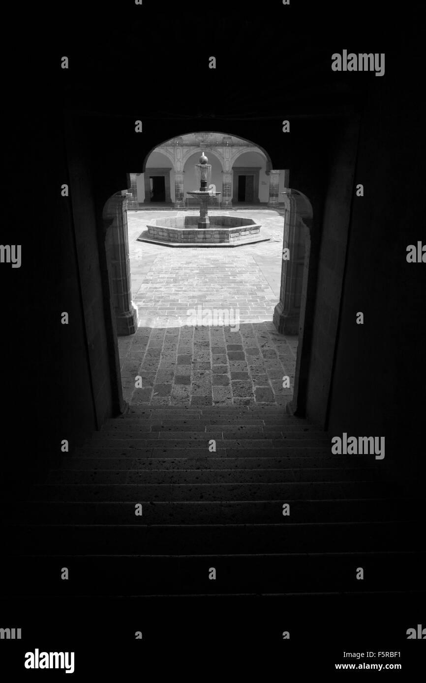 Black and white image of the fountain in the courtyard of Palacio Clavijero in Morelia, Michoacan, Mexico. - Stock Image