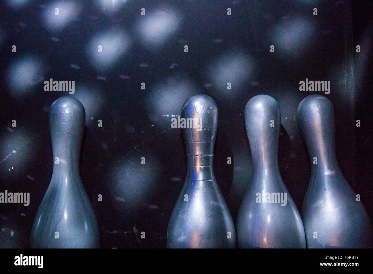 four bowling pins - Stock Image