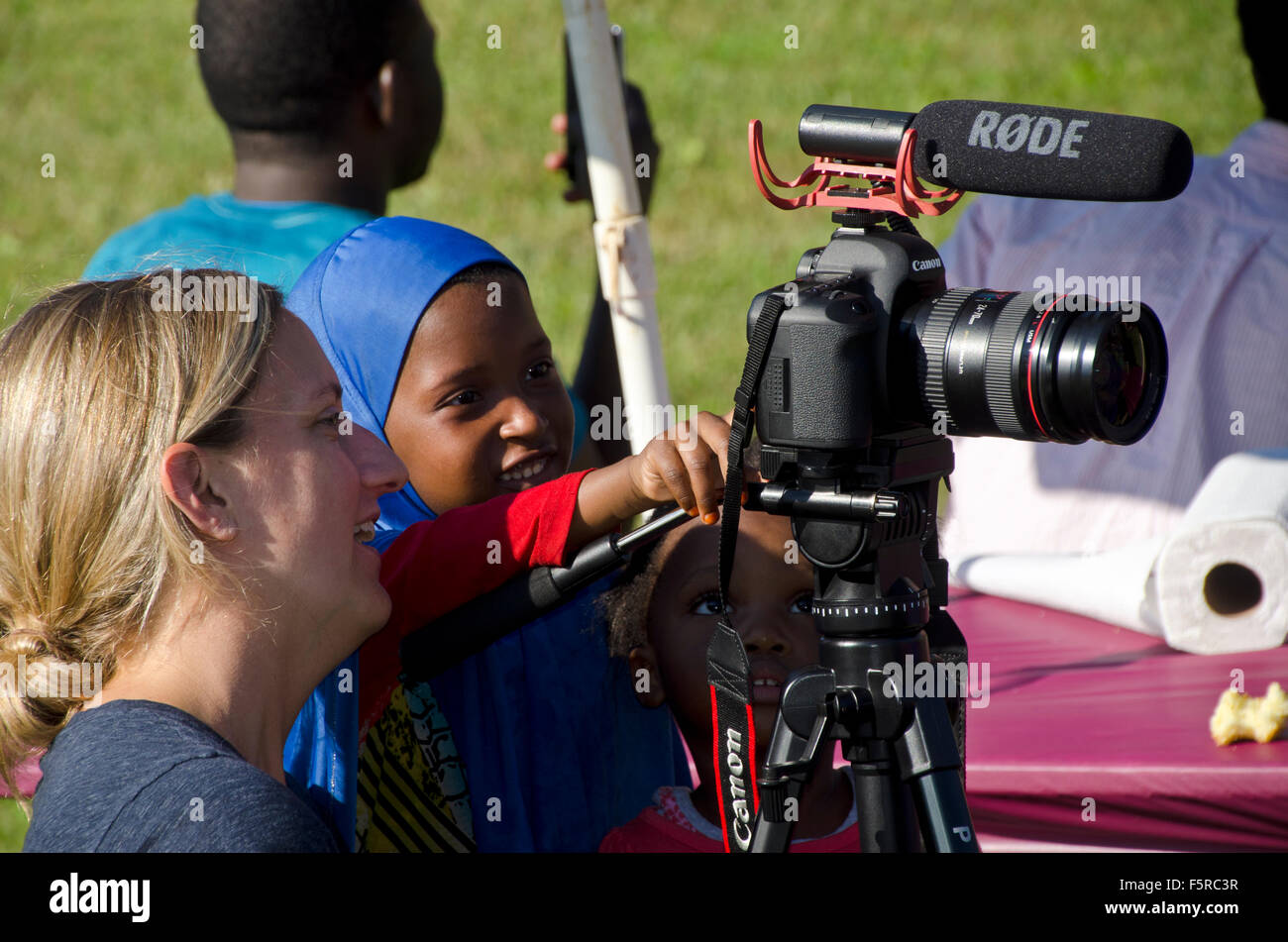 Young woman from Colby College  demonstrating video filming to young Bantu woman, New Gloucester Maine, USA - Stock Image