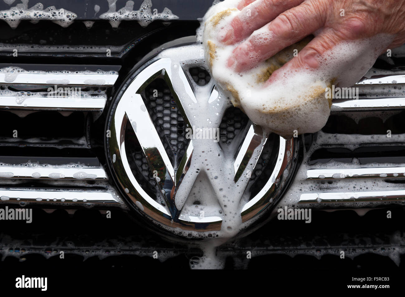 Hand washing a VW car in the U.K. - Stock Image
