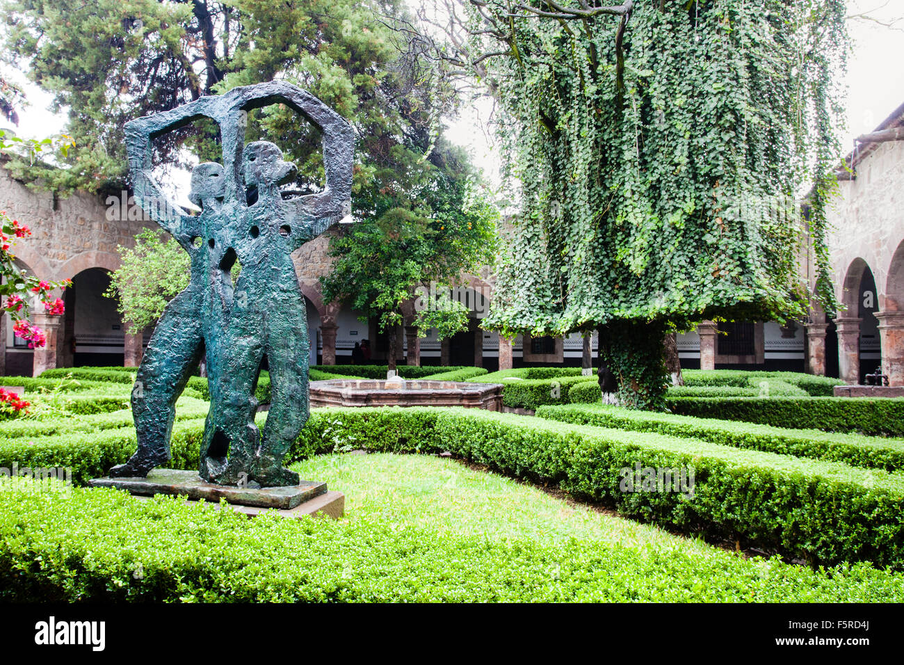 Interior courtyard of the Rosas Music Conservatory with a sculpture by Alfredo Zalce in Morelia, Michoacan, Mexico. - Stock Image