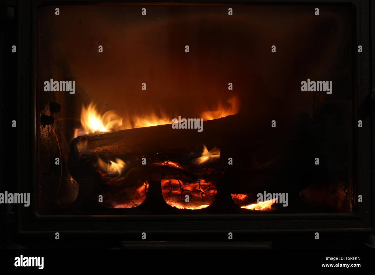 Fire behind the fire screen - Stock Image