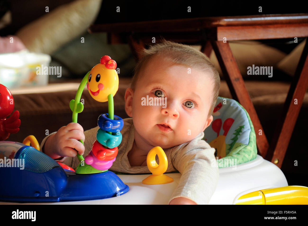 6 Month Old Baby Girl In Seat With Toys Stock Photo 89643494 Alamy