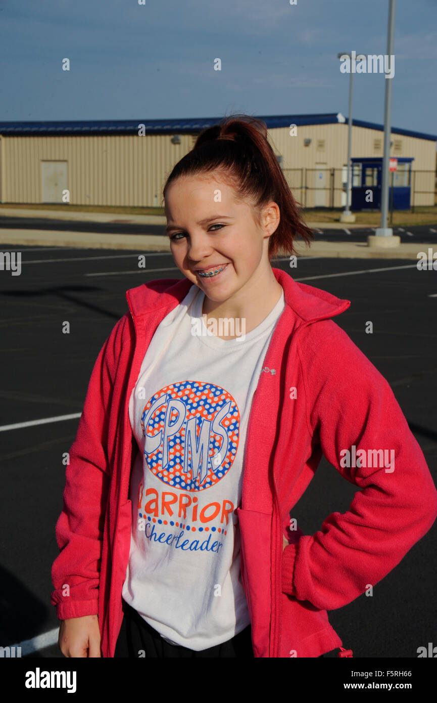 Teen girl with junior high school t-shirt on. - Stock Image