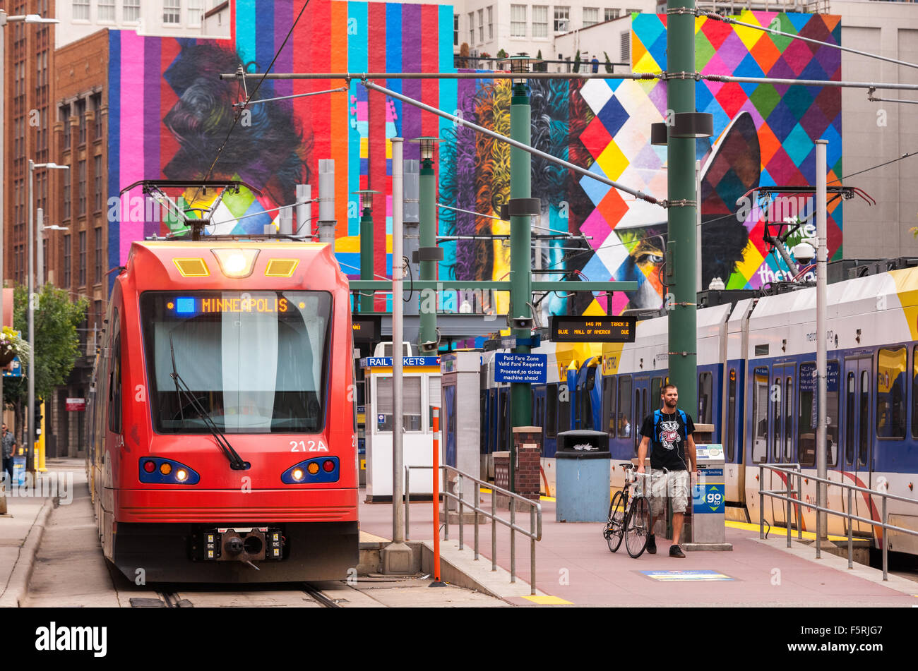 Downtown Minneapolis. Metro Transit Blue Line Hiawatha Light Rail at Warehouse Hennepin stop. Bob Dylan Mural in - Stock Image