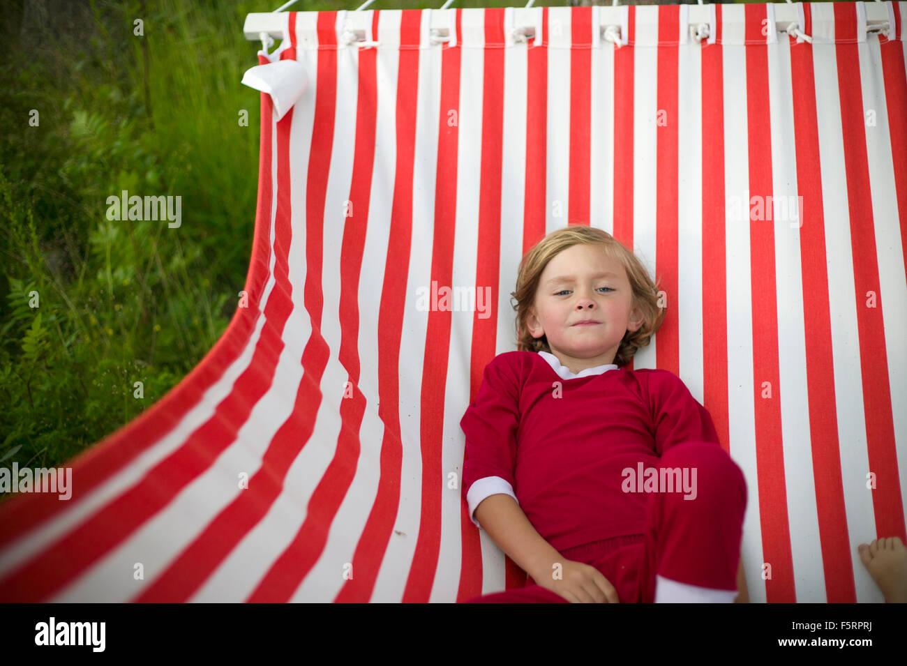 Sweden, Dalarna, Leksand, Boy (6-7) in hammock Stock Photo