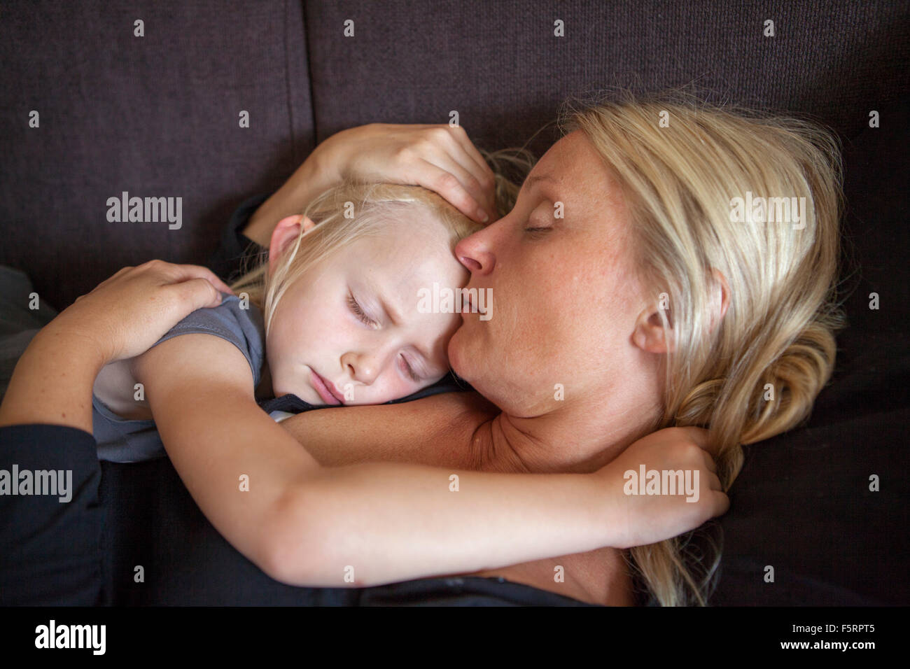 Sweden, Vastergotland, Lerum, Mother and daughter (6-7) embracing - Stock Image