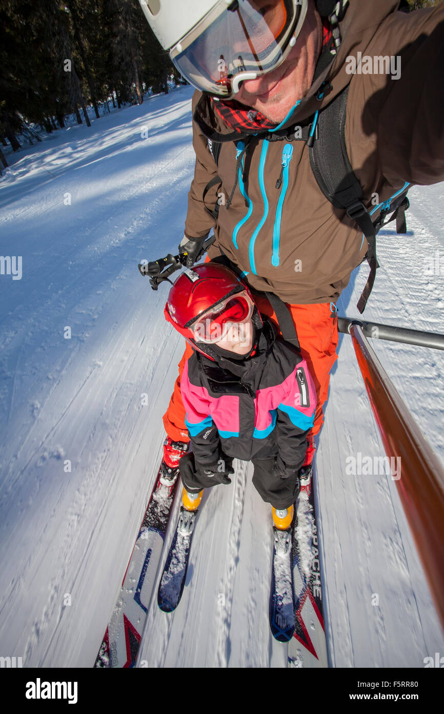 Norway, Osterdalen, Trysil, Selfie portrait of girl (6-7) and her dad skiing - Stock Image