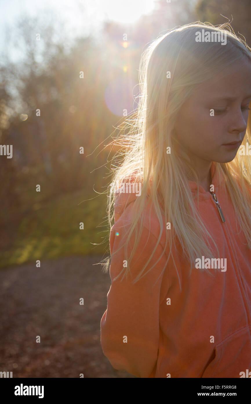 Sweden, Vastergotland, Lerum, Girl (10-11) in sunlight - Stock Image