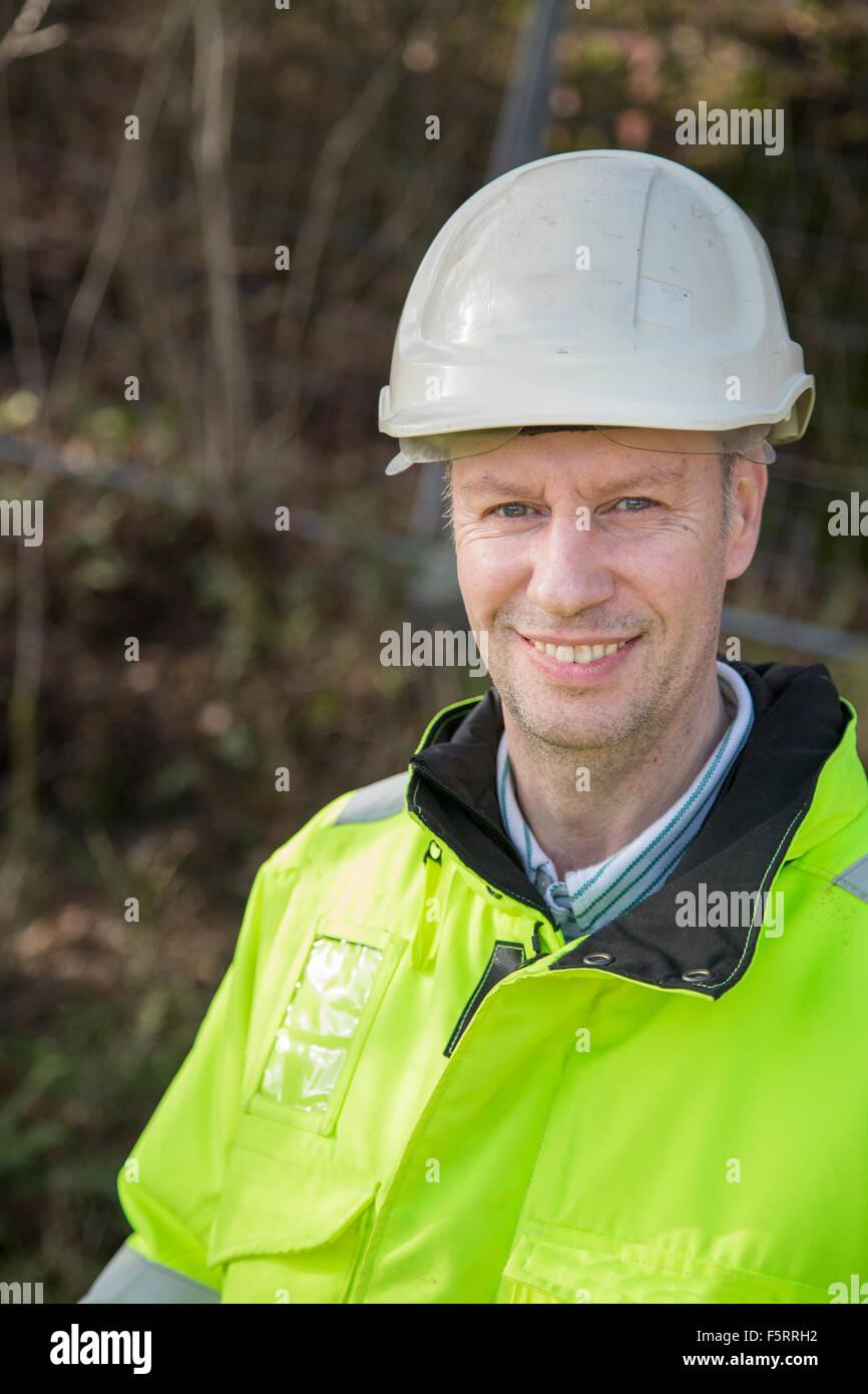 Sweden, Bohuslan, Torslanda, Portrait of construction worker - Stock Image