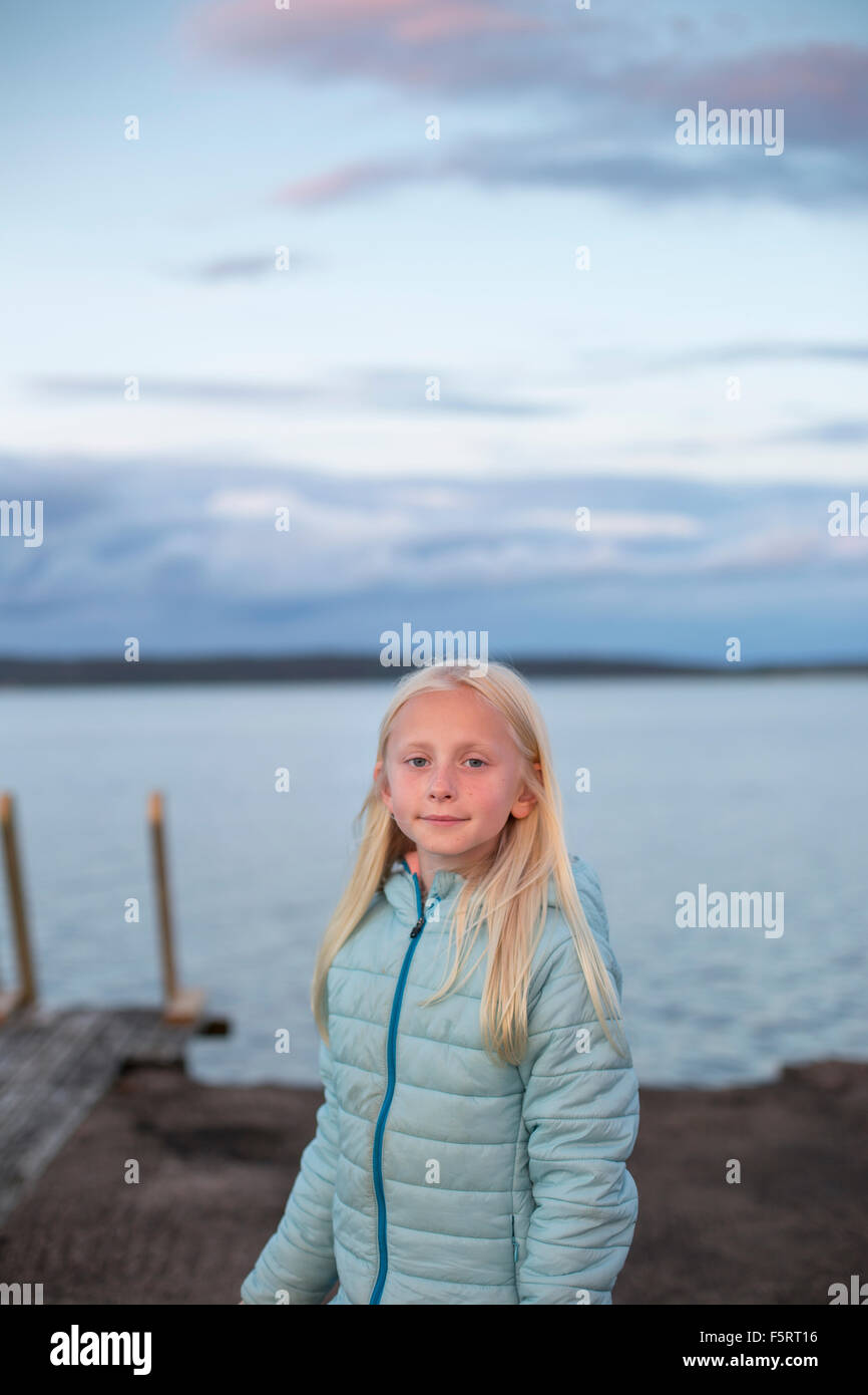 Sweden, Halland, Onsala, Portrait of girl (10-11) in front of lake Stock Photo