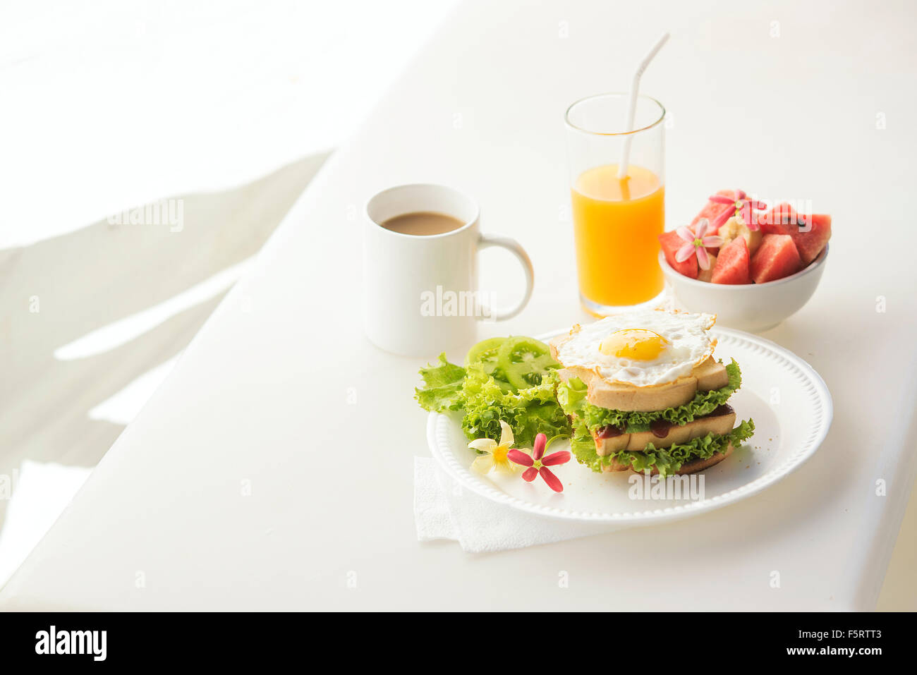 egg and salad sandwich with fruit salad juice and coffee breakfast set - Stock Image