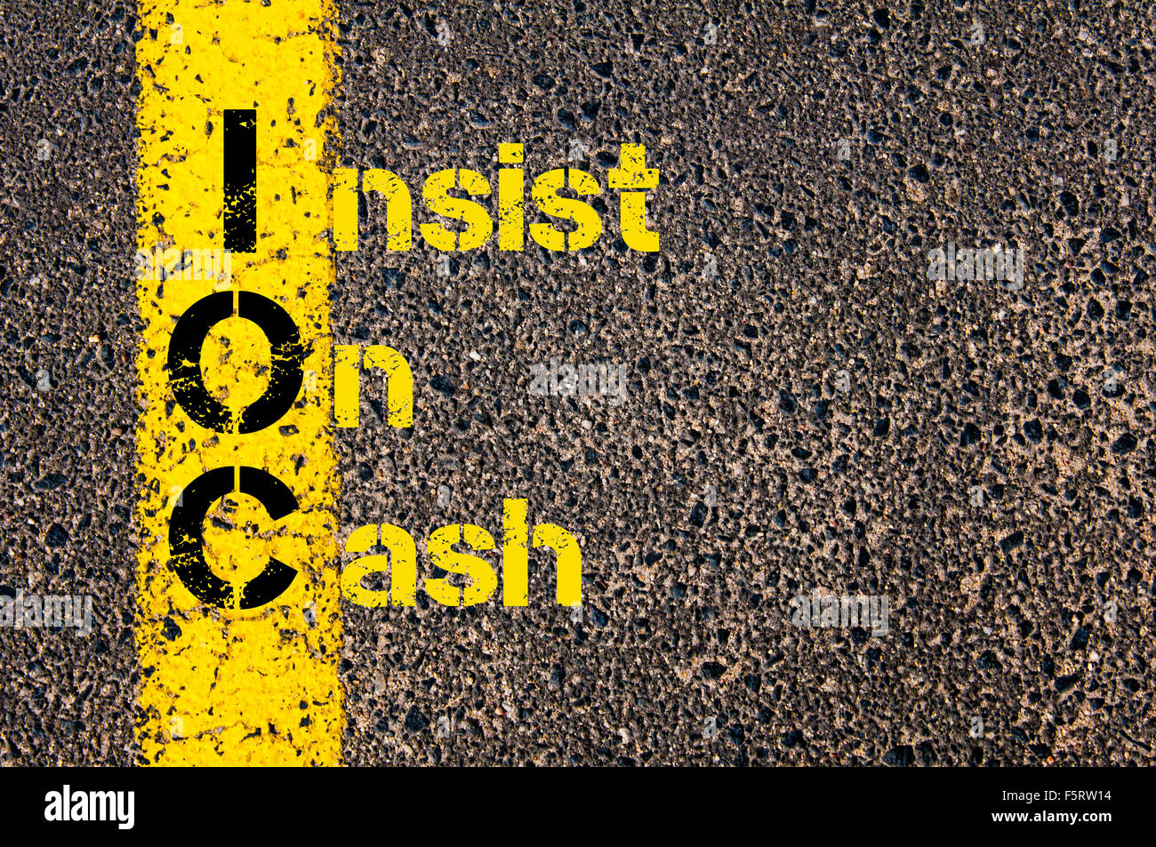 Concept image of Business Acronym IOC as Insist On Cash written over road marking yellow paint line. - Stock Image