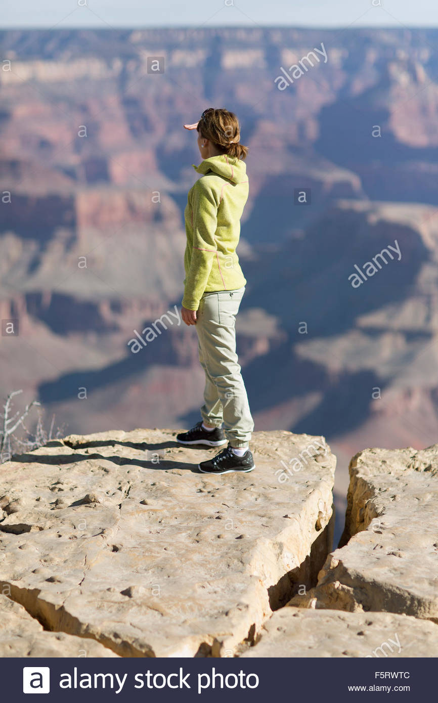 USA, Arizona, Grand Canyon, Woman standing on edge and looking at view Stock Photo