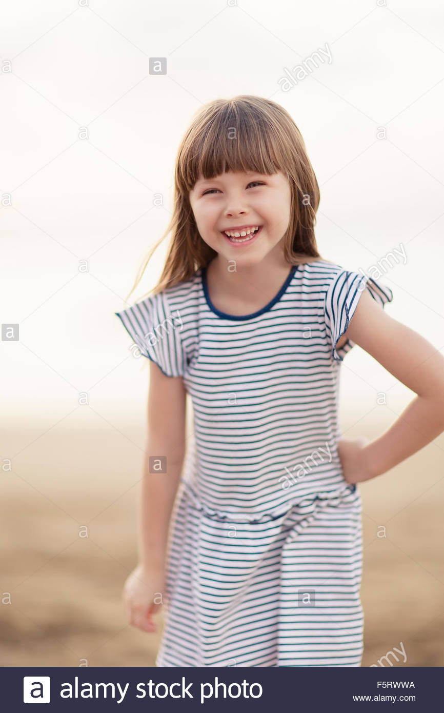 Spain, Las Palmas, Portrait of smiling little girl (4-5) - Stock Image