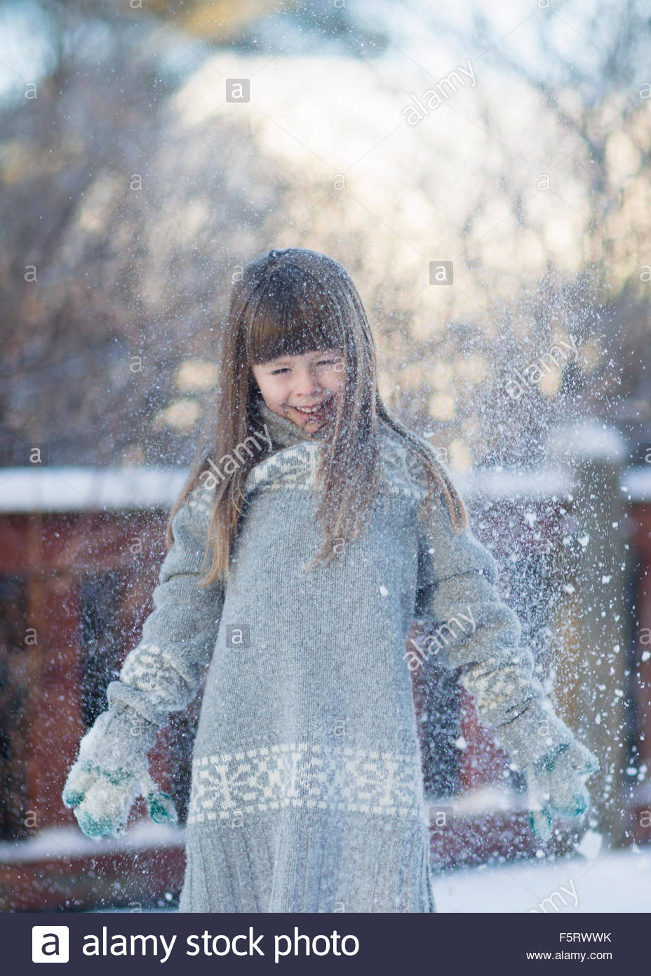 Sweden, Vasterbotten, Little girl (4-5) playing with snow Stock Photo