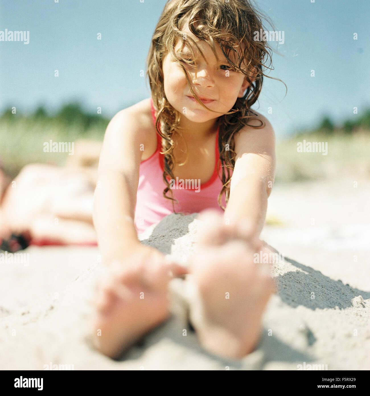 Sweden, Oland, Cute girl (4-5) on beach - Stock Image