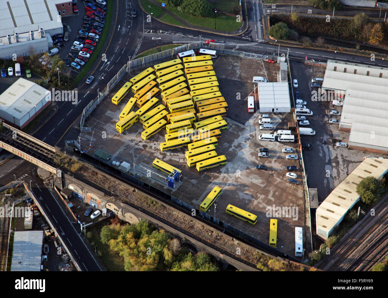 aerial view of yellow buses parked in a compound in UK - Stock Image