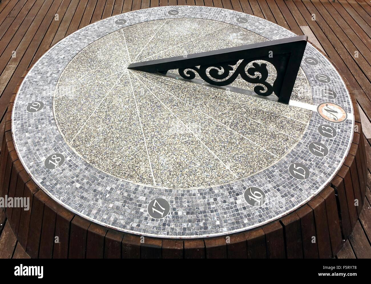 A large sundial timepiece that is aligned with the true north - Stock Image