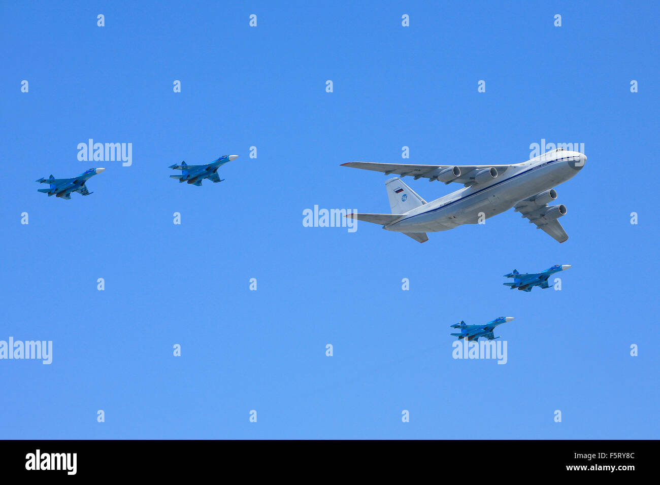 An Antonov AN-124-100 of the 224th Flight Unit flanked by 4 Sukhov Su-27s during the Victory Day Parade in Moscow, - Stock Image