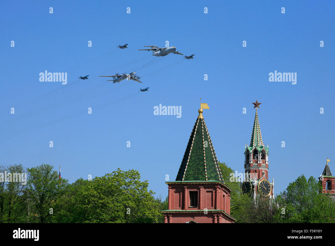 4 Russian MiG-29 fighter jets, an Ilyushin Il-78 refueling tanker and a Tupolev Tu-95 turboprop long range bomber - Stock Image