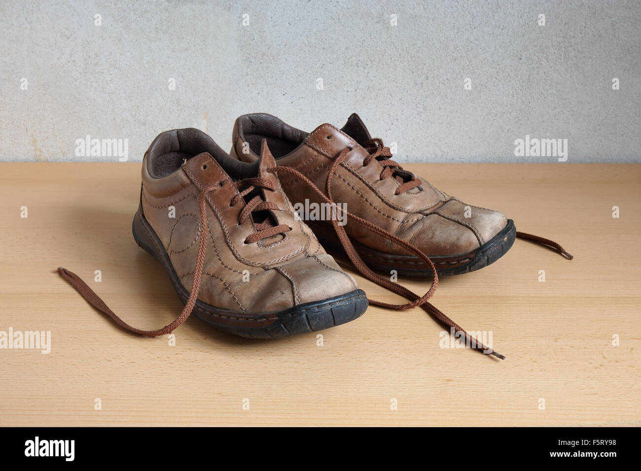 old worn out shoes - Stock Image