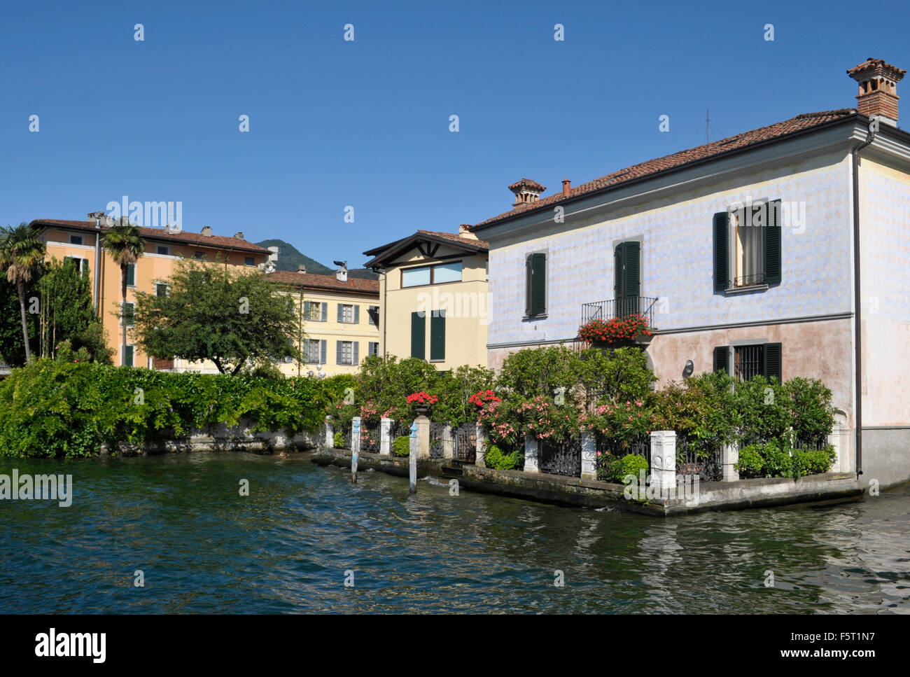 houses on the shore of Lake Iseo in Iseo town - Lombardy - Italy - Stock Image