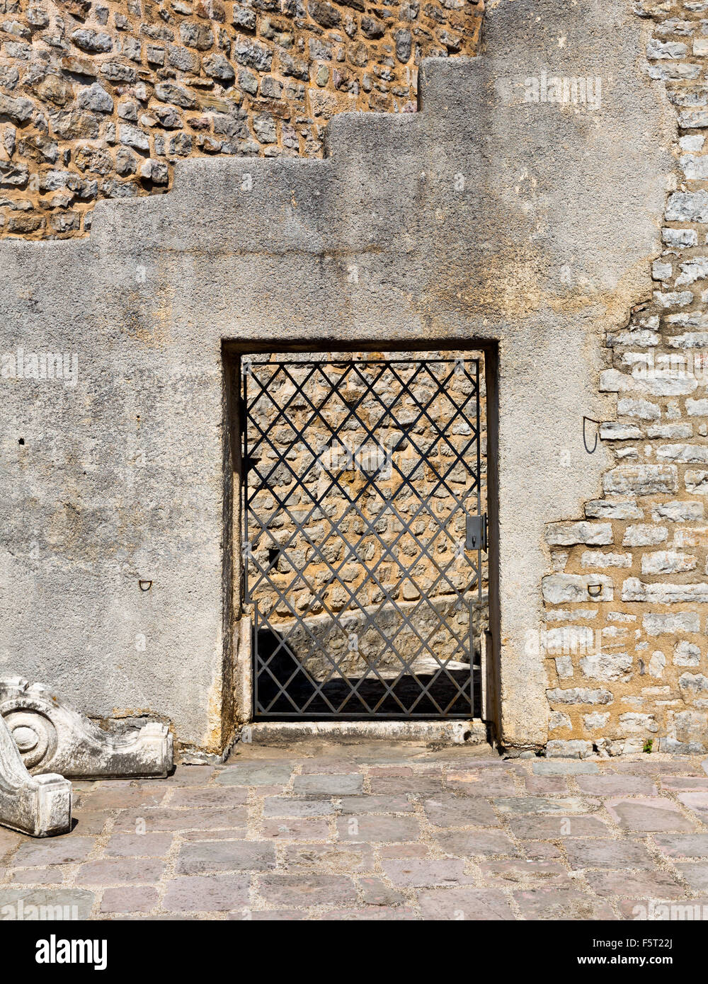 Arched old lattice door in a stone wall & Arched old lattice door in a stone wall Stock Photo: 89653610 - Alamy