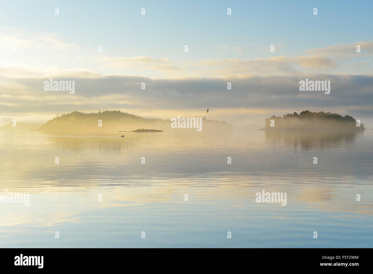 Sweden, Stockholm Archipelago, Uppland, Lidingo, View of sea and islands at dawn Stock Photo