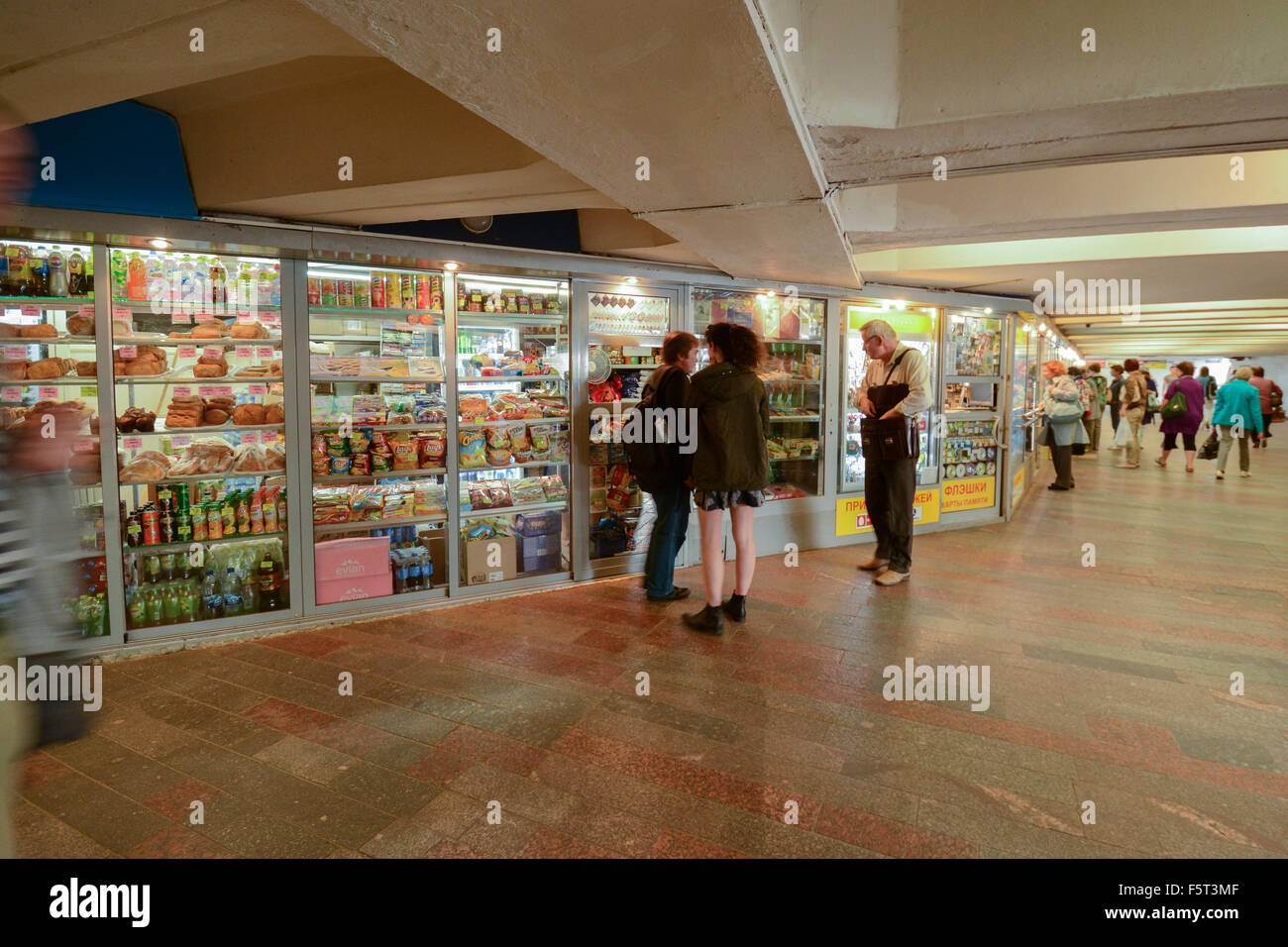 Shops in a pedestrian underpass leading to Moscow Metro - Moscow, Russia - Stock Image