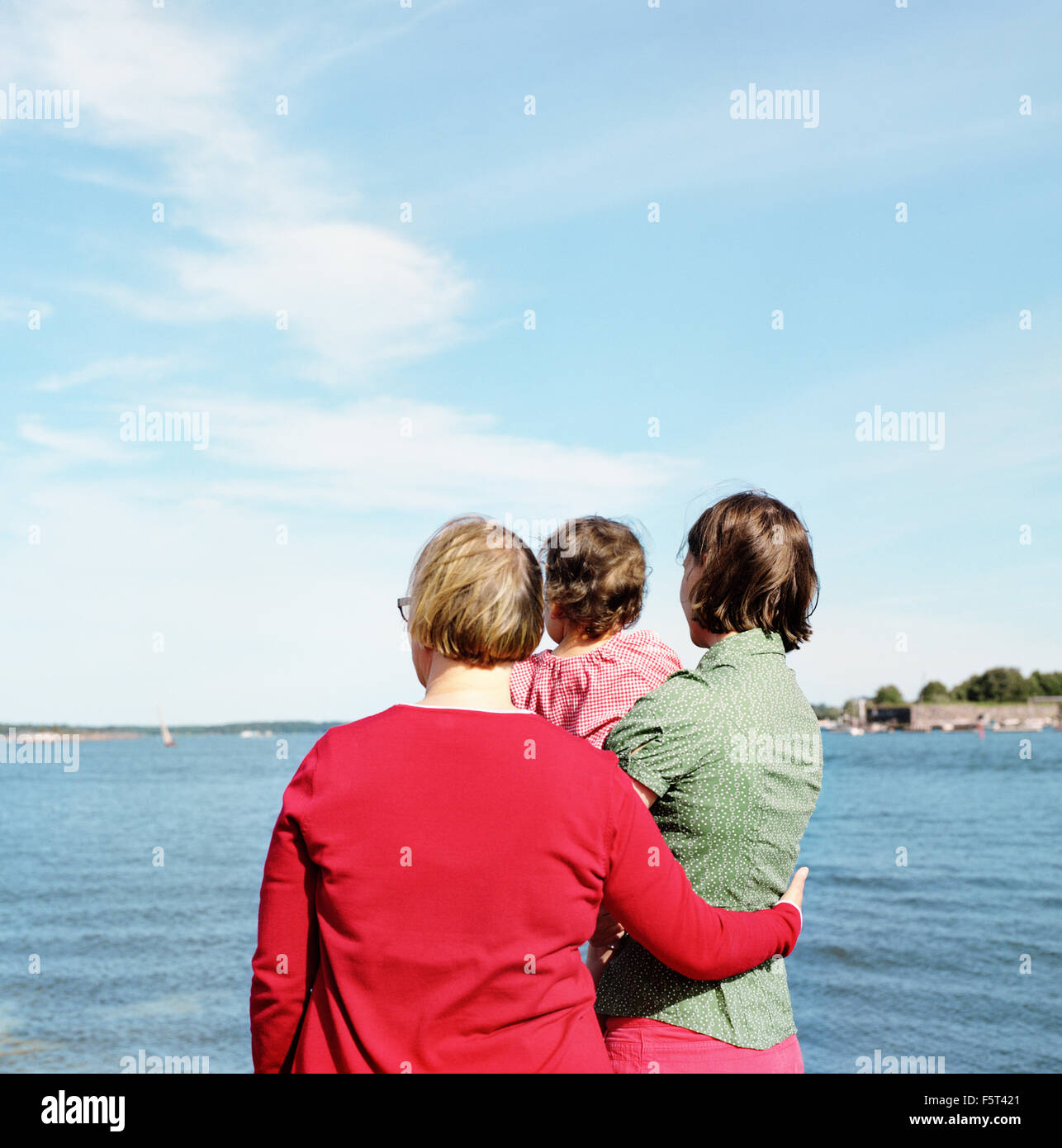 Finland, Helsinki, Uusimaa, Rear view of mother, daughter (2-3) and grandmother - Stock Image