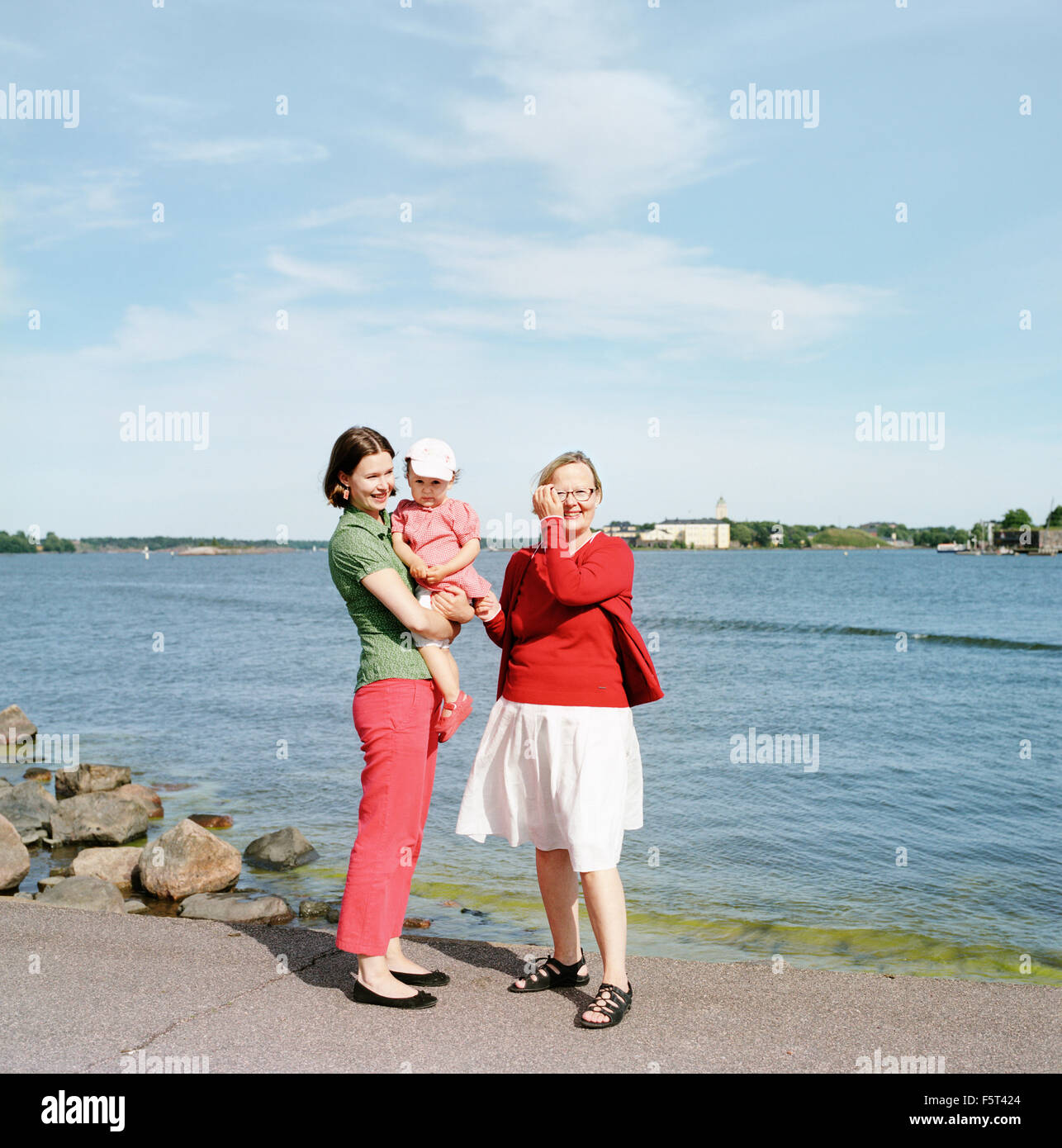 Finland, Helsinki, Uusimaa, Portrait of mother, daughter (2-3) and grandmother - Stock Image