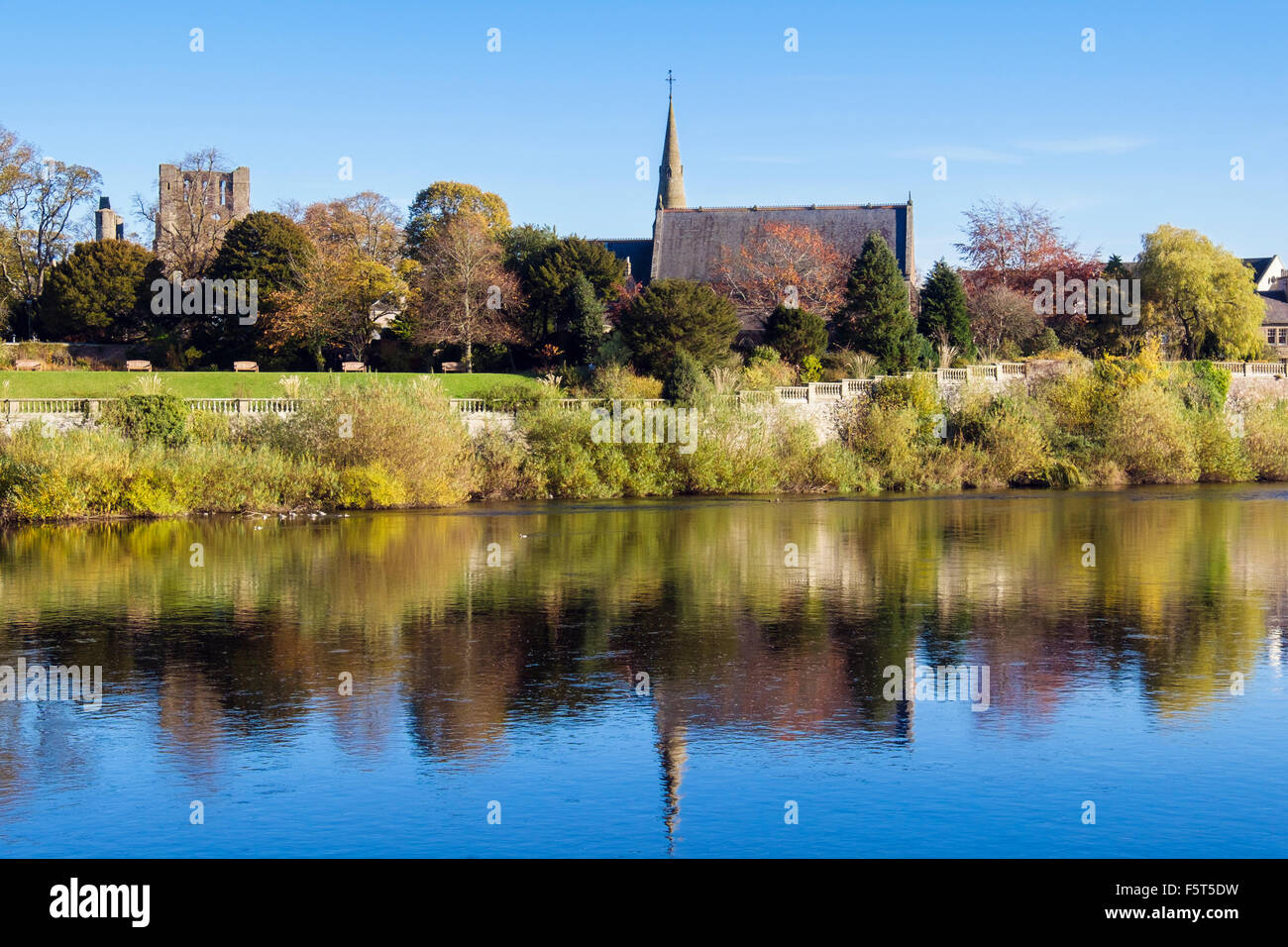 Reflections of Abbey and St Andrews church from across the River Tweed. Kelso, Berwickshire Scottish Borders Scotland - Stock Image